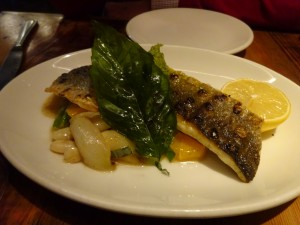 Oak grilled branzino, braised white bean, tangerine, spring onion, escarole