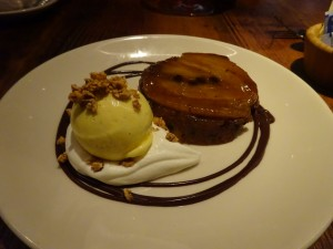 Olive oil upside-down cake, banana, toffee, candied hazelnuts, vanilla malt ice cream