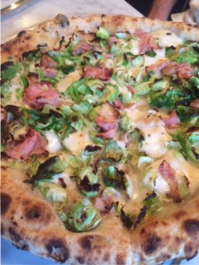 Brussels sprouts pizza with garlic, pecorino, and smoked pancetta