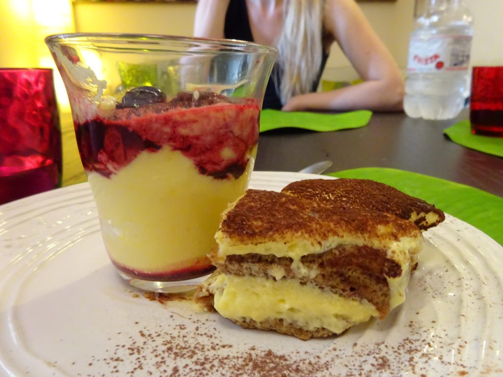 Cherries with cream and tiramisu